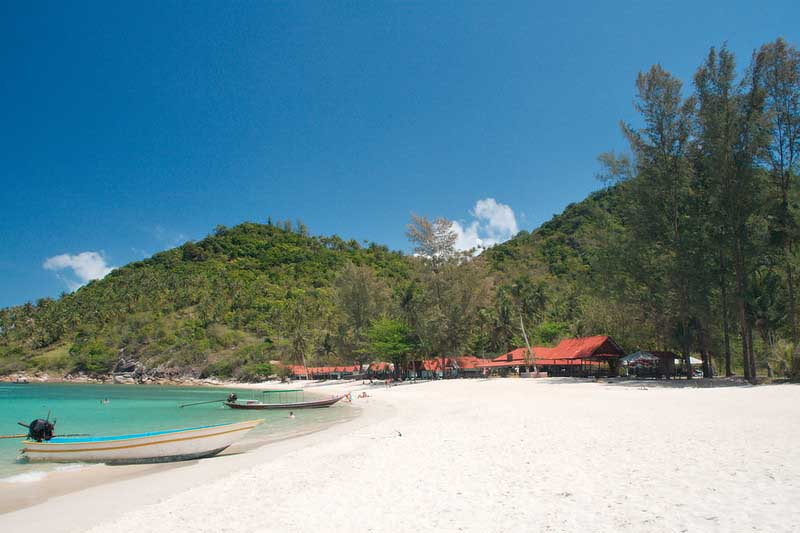White sand and turquoise waters of Bottle Beach on Koh Phangan, one of the best beaches in Thailand