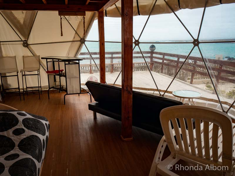 Inside a glamping tent looking out at the ocean in one of many hotel alternatives in Chile