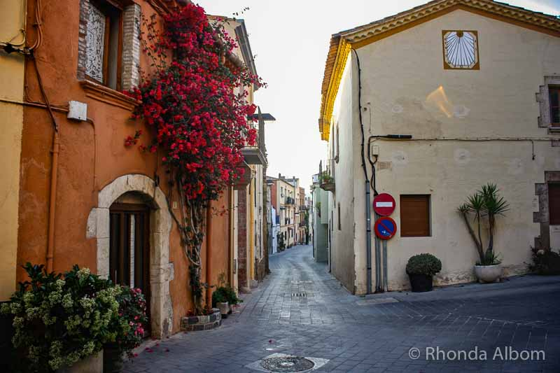 A street in the medieval section of Palamos Spain that has a home exchange house offered as a hotel alternative
