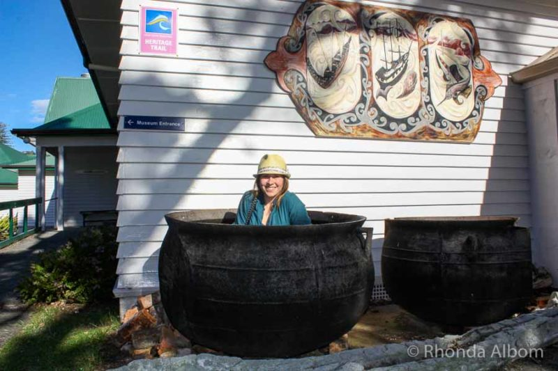 Girl posing in a whaling pot in New Zealand
