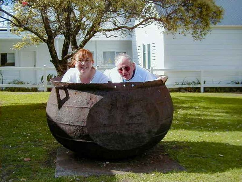 Two people in a whaling cauldron in New Zealand