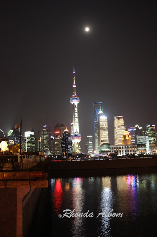 Shanghai China skyline at night over the Huangpu River