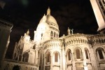 Night Photo of Sacre Coeur Against a Black Sky in Paris France