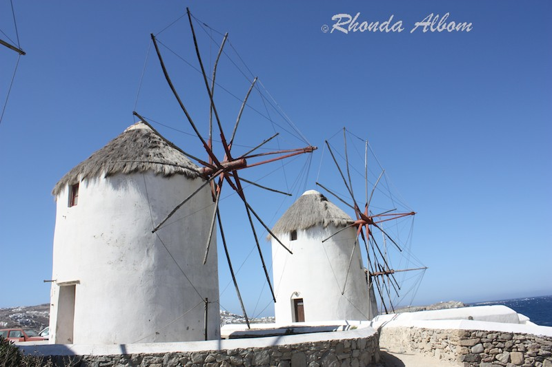 Windmills of Mykonos, Greece - Stark white against a blue sky.