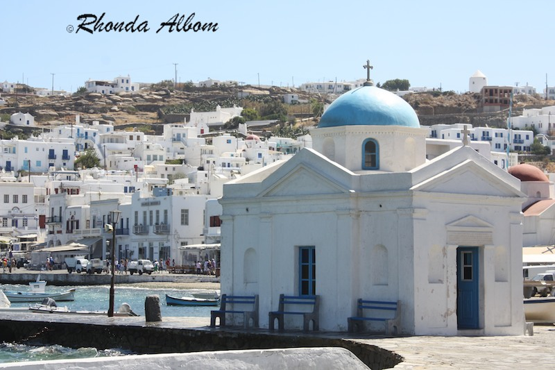 One of many old churches that is still in use, with the town of Mykonos in the background.