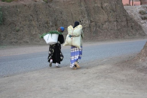 women carrying packs in Morocco