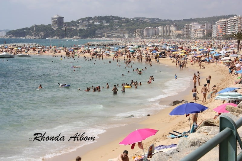 Typical Crowded Summer Day at the Beach in Palamos, Spain