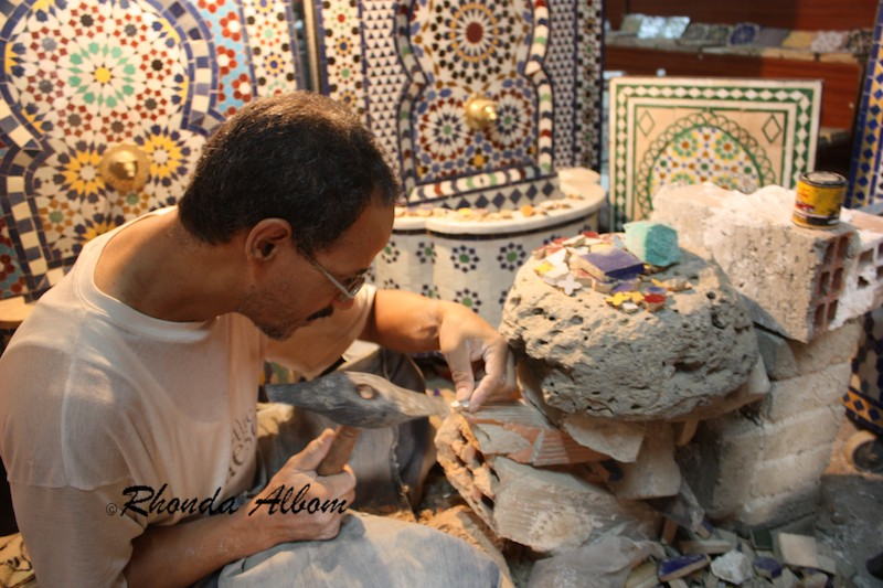 Creating Mosaic by Carving One Tiny Tile at a Time requires patience and expert craftsmanship