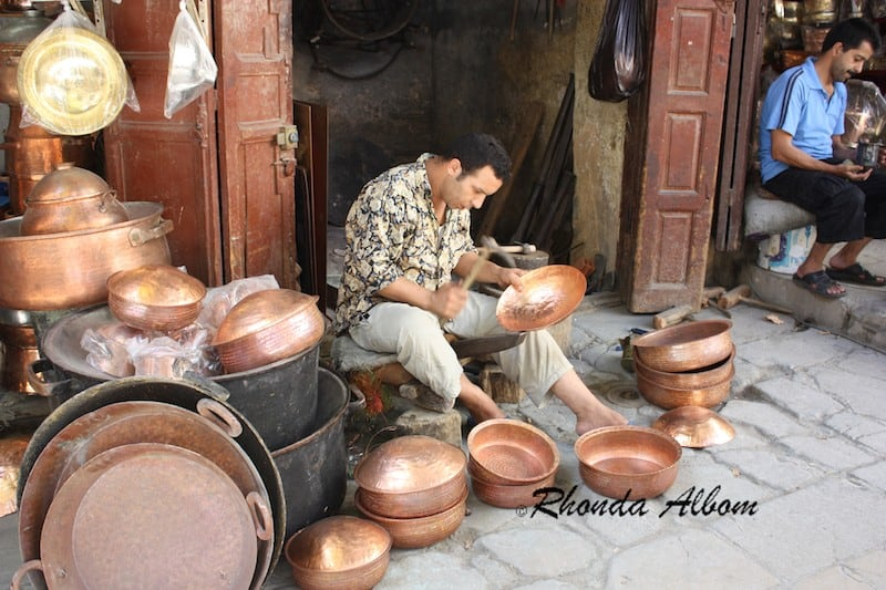 Coppersmiths Hammer Pots and Other Wares in Seffarine Square in the Old Medina of Fez, Morocco