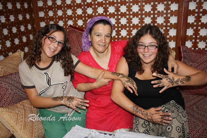 Expert Henna Applied to Arms and Hands in Morocco
