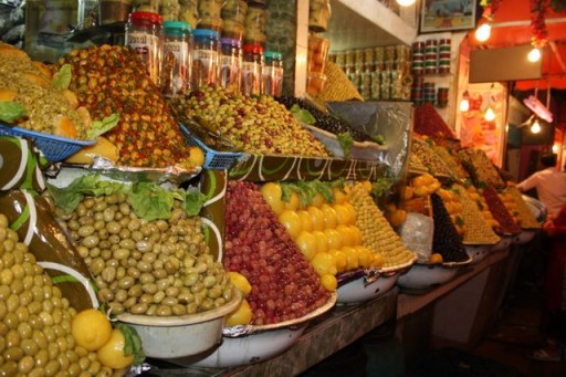 Colorful olives on display at a spice market in Meknes, Morocco