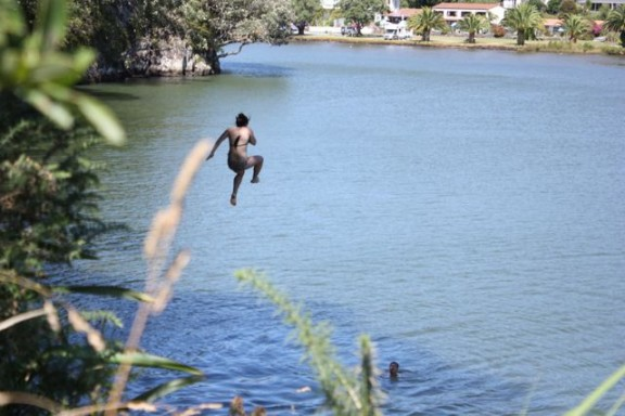 jumping into haruru falls New Zealand