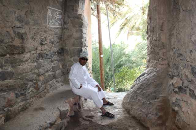 Our guide shows us where the old men in the village of Misfat Oman would gather each morning.