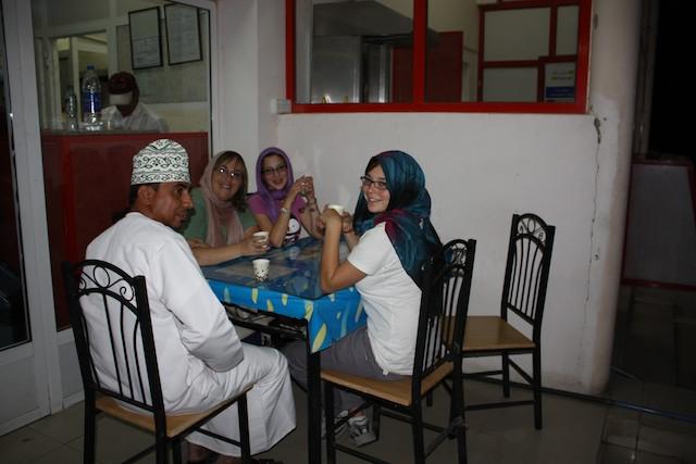 Enjoying Omani tea, outside Muscat.