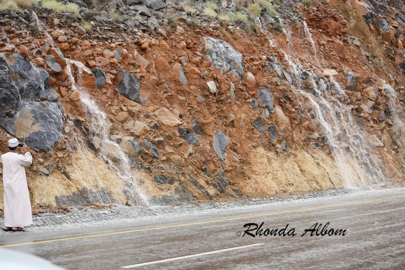 Rain water rushs down the rocks at the start of the desert floods in Oman, April 2012