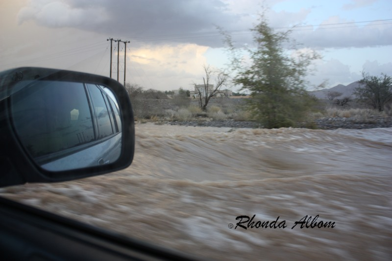 Deep flood waters outside our car window during flash floods in the normally dry desert of Oman, April 2012