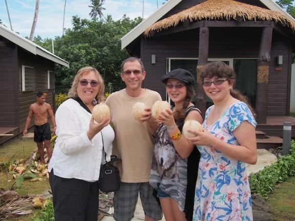 Enjoying the fresh coconut milk