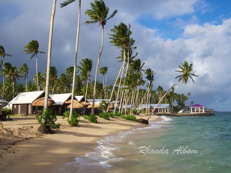 Palm trees line the beach at Saletoga Sands Resort in Samoa