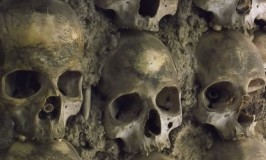 A close up of the skulls embedded in the wall of the Chapel of Bones in Evora Portugal. Photo ©Sarah Albom