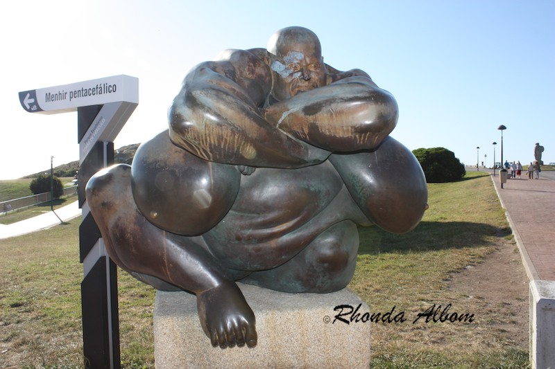 Funny Statue with huge body parts near the Tower of Hercules, La Coruna, Spain