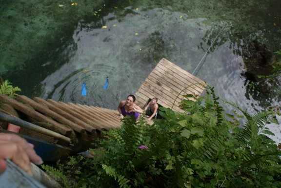 ©Karen Ellen 2014. Used with permission. Climbing up the ladder at exit the sink hole at To Sua Ocean Trench, Samoa