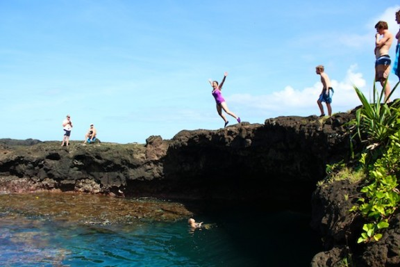 Jumping into the Lava Caves at To Sua Ocean Trench, Samoa