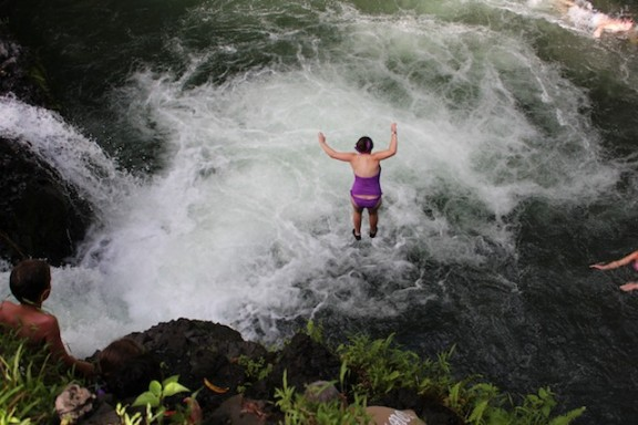 Jumping into the Togitogiga Waterfall from an Eight Meter, Samoa