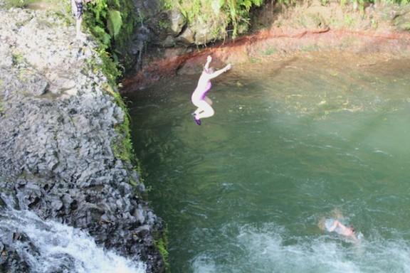 Jumping into the Togitogiga Waterfall, Samoa