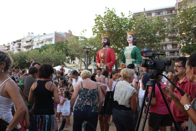 The giant king and queen look on as we are dancing in the streets at a festival in Spain